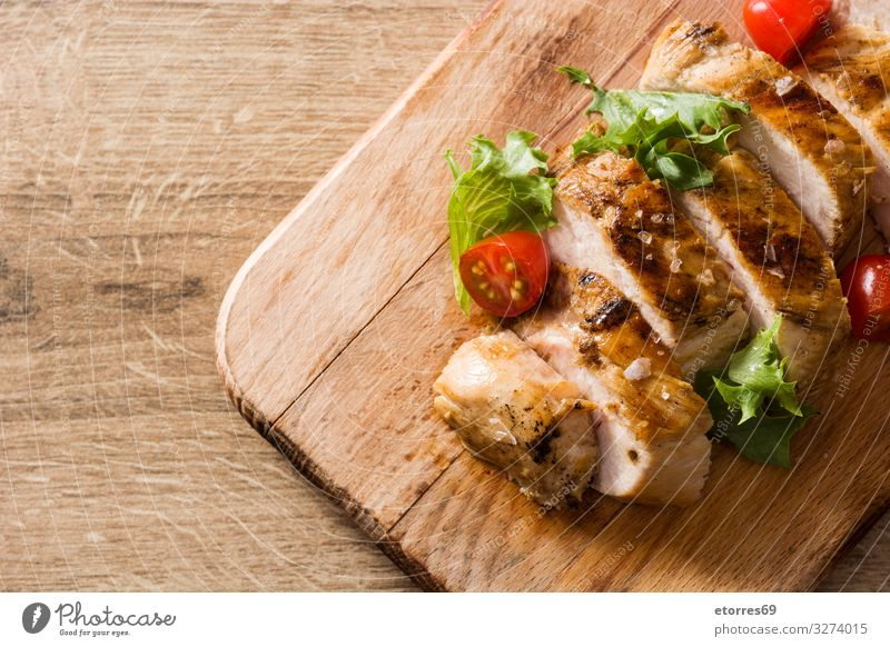Grilled chicken breast with vegetables on wooden table Food Healthy Eating Food photograph Chicken Meat Meal Dinner Plate Salad Frying BBQ Roasted fish Tomato