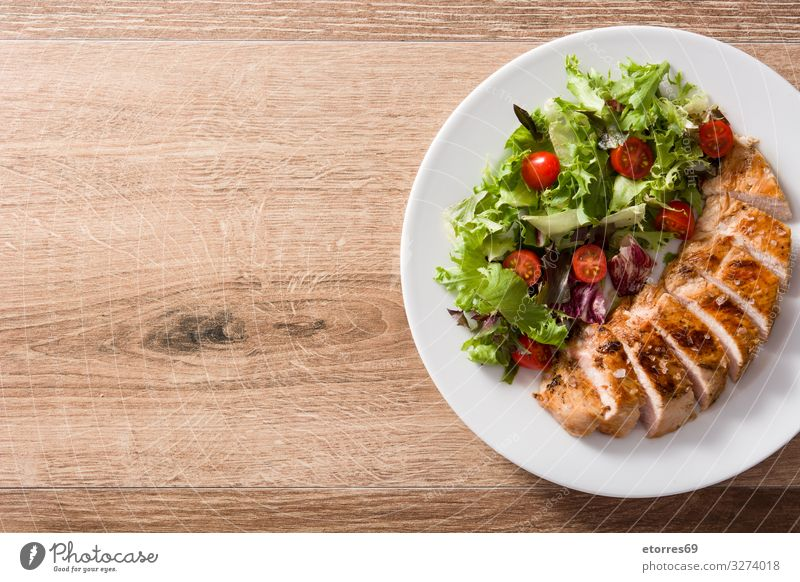 Grilled chicken breast with vegetables on wooden table. Food Healthy Eating Food photograph Meat Meal Salad Dinner Plate Chicken BBQ White Tomato Pork Frying