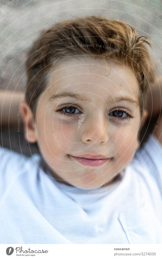 Close up of a cute boy lying Child Human being Vacation & Travel Nature Summer Beautiful Relaxation Calm Joy Beach Face Eyes Lifestyle Happy Boy (child) Small