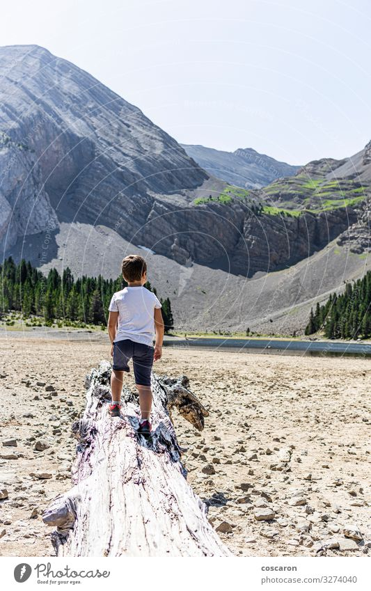 Little kid looking a dry mountain lake Child Human being Vacation & Travel Nature Summer Landscape Tree Calm Joy Forest Beach Mountain Lifestyle Environment