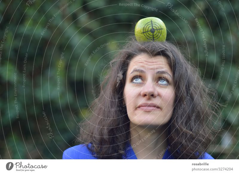 lost | if he does not hit - woman with apple on her head on which a target is drawn, looks very sceptical apples Woman Adults Head 30 - 45 years brunette Arrow