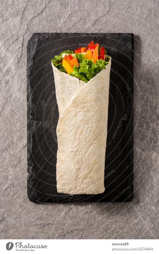 Vegetable tortilla wraps on gray stone background. Top view Wrap Roll Flat bread Food Healthy Eating Food photograph Spring Vegetarian diet Mix Carrot Lettuce