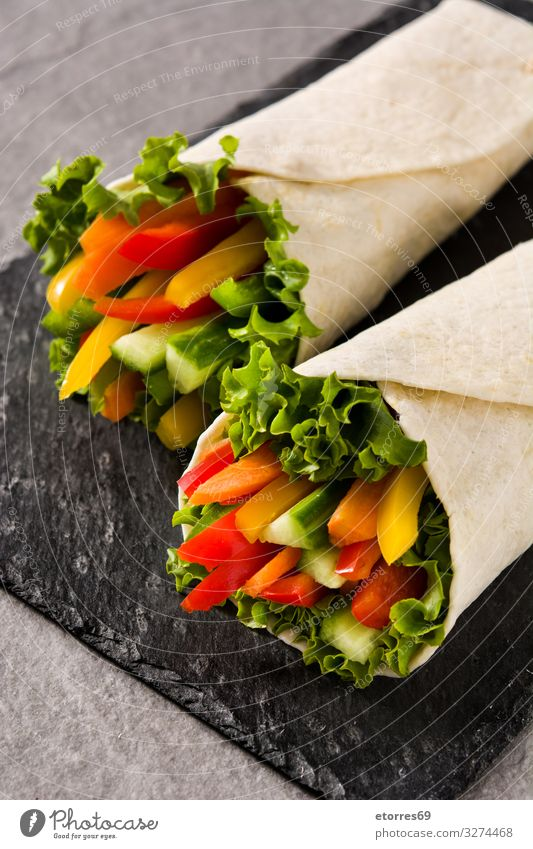 Vegetable tortilla wraps on gray stone background Wrap Roll Flat bread Food Healthy Eating Food photograph Spring Vegetarian diet Mix Carrot Lettuce Tomato