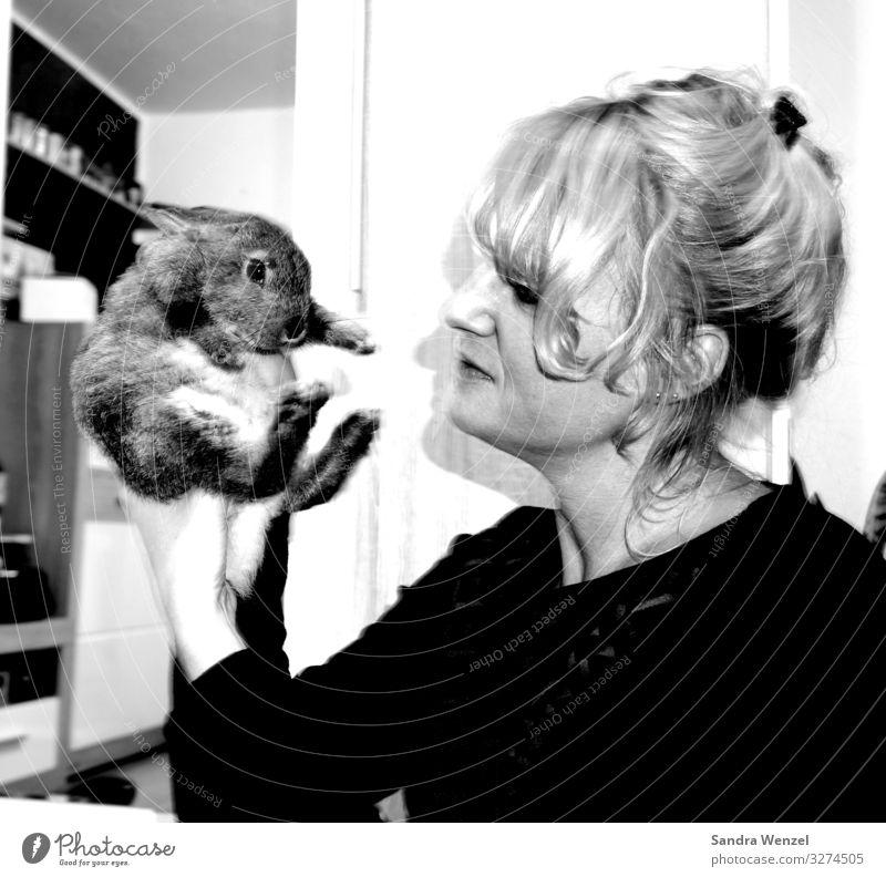 Lumpi Human being Feminine Woman Adults 1 30 - 45 years Animal Feeding Stop rabbit rabbit Hare & Rabbit & Bunny Black & white photo