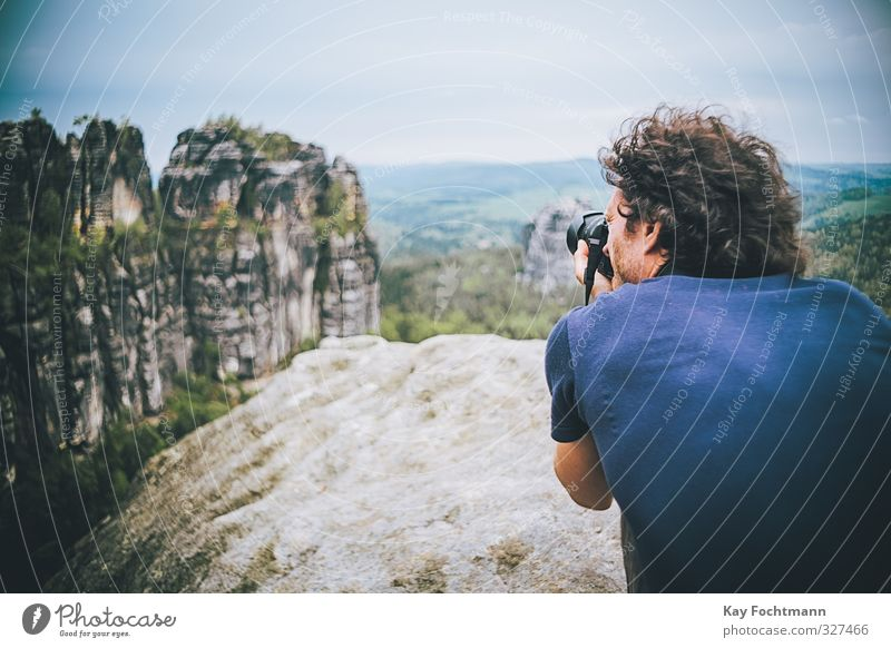 Young man takes photos of the Elbe Sandstone Mountains Lifestyle Vacation & Travel Tourism Trip Adventure Freedom Summer vacation Hiking Camera Masculine Man