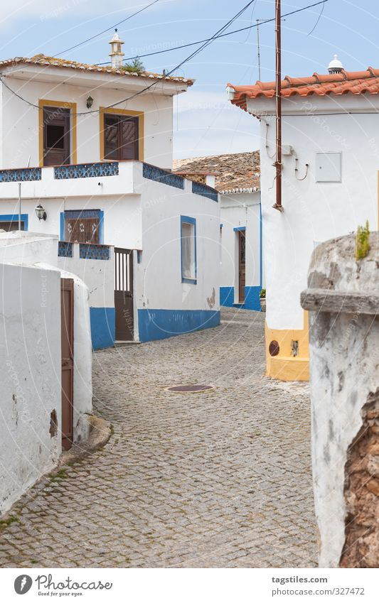 RIGHT - LEFT - RIGHT - LEFT - RIGHT ... Portugal Algarve rapeseed Right Left Change in direction Town Small Town House (Residential Structure) Street