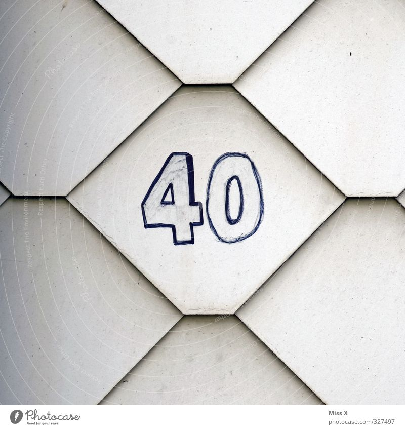 40* House (Residential Structure) 30 - 45 years Adults Wall (barrier) Wall (building) Characters Digits and numbers Old Birthday House number Colour photo