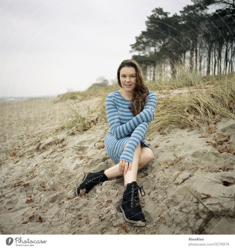 Young woman sitting on dune at the Baltic Sea beach Style Joy Beautiful Life Well-being Trip Adventure Youth (Young adults) Adults 18 - 30 years Landscape