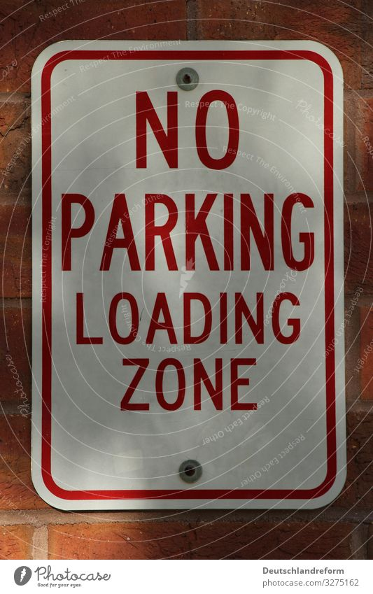 No Parking Wall (barrier) Wall (building) Road traffic Motoring Road sign Work and employment Town Red White Bans Colour photo Exterior shot Close-up