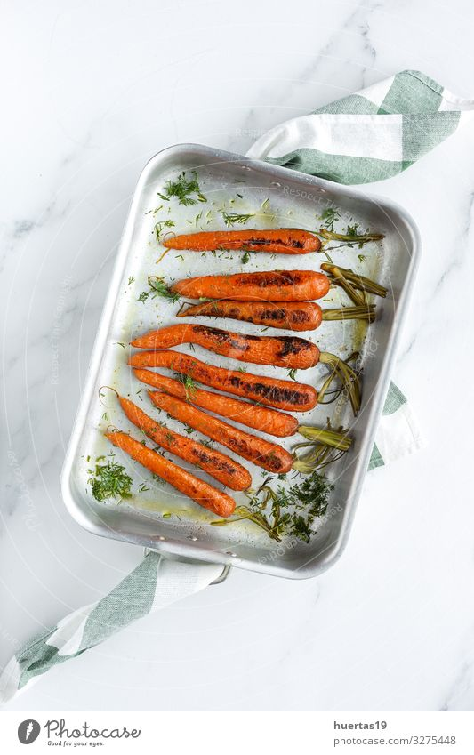 Delicious roasted carrots from above Food Vegetable Herbs and spices Lunch Dinner Vegetarian diet Diet Lifestyle Healthy Eating Fresh Natural Above Orange