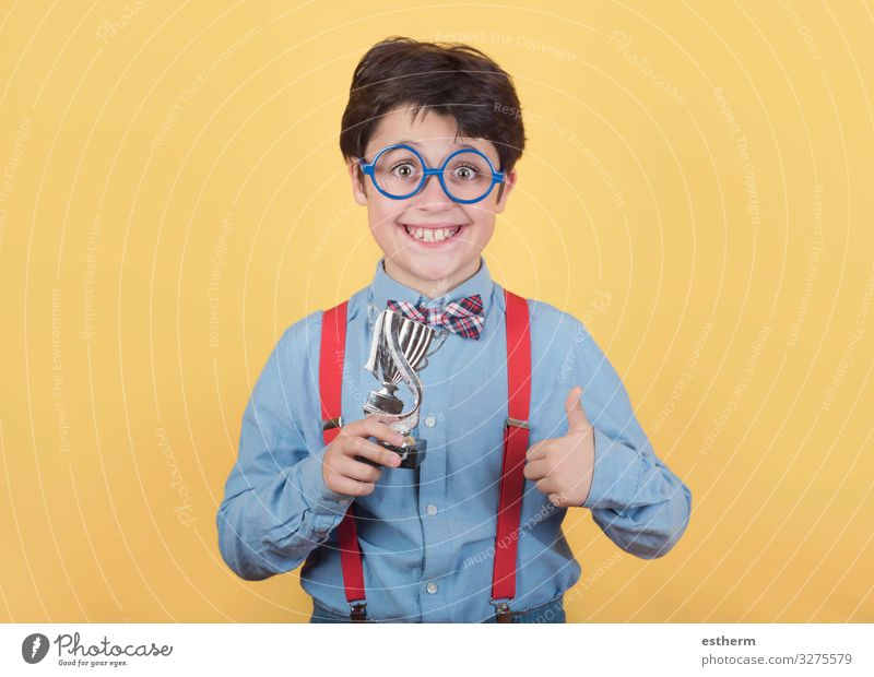 Happy boy with winning cup Playing Chess Feasts & Celebrations Award ceremony Success Science & Research Child School Schoolchild Human being Masculine Infancy