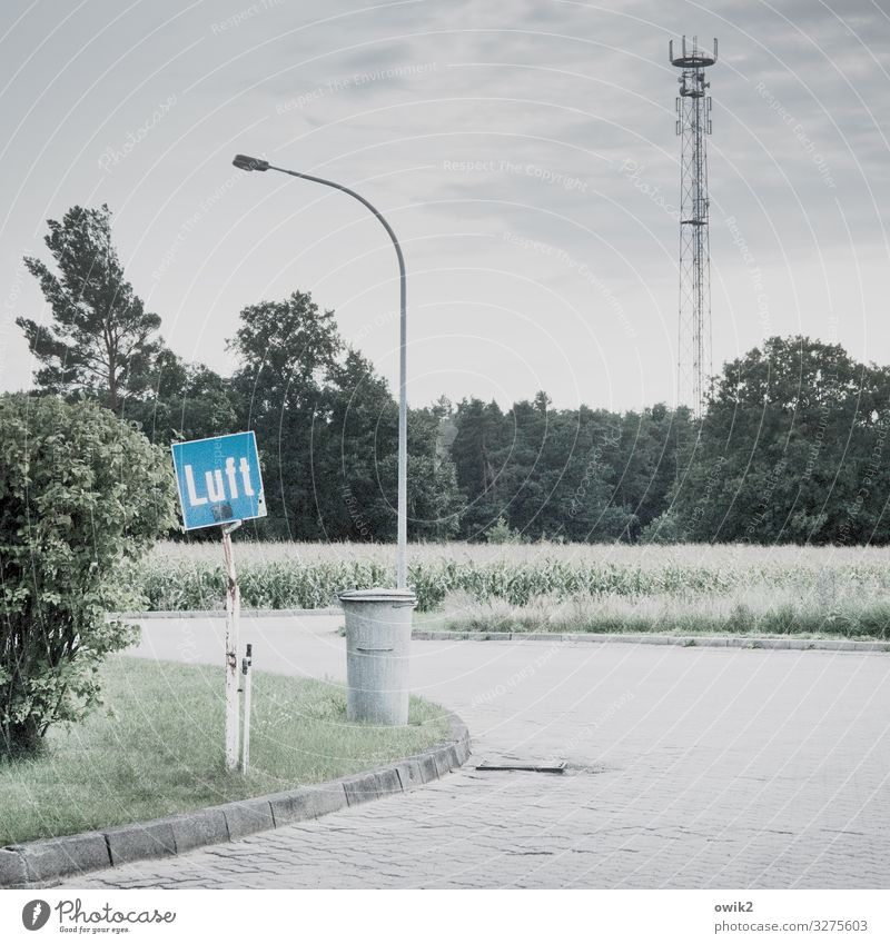 Aerial view Sky Clouds Tree Grass Bushes Field Forest Street Petrol station Air Trash container Stone Metal Characters Signs and labeling Signage Warning sign