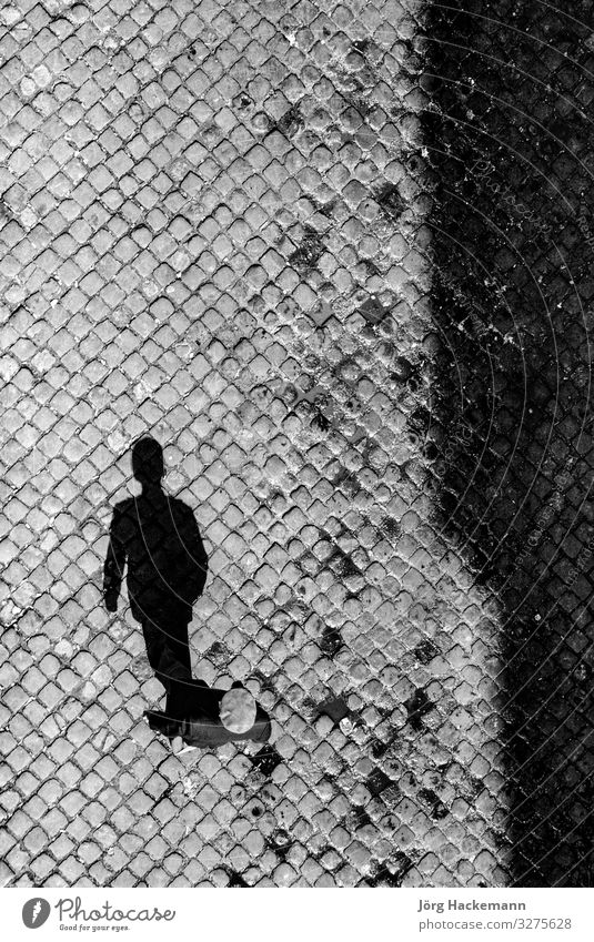 shadow of senior man on cobble stone Man Adults Aircraft Old Tradition Portugal Spain Age cap Classic Cobblestones head Lisbon Symbols and metaphors