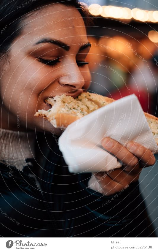 delicatessen Feminine Young woman Youth (Young adults) Woman Adults 18 - 30 years Eating To enjoy garlic bread Christmas Fair Appetite Delicious Hearty