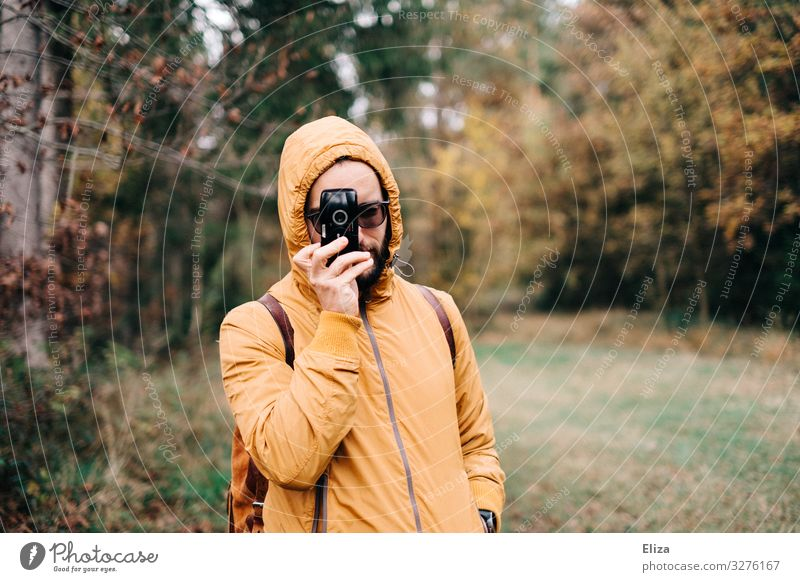 vis-à-vis Masculine 18 - 30 years Youth (Young adults) Adults 30 - 45 years Leisure and hobbies Nature Photographer Forest Camera Take a photo Yellow Autumn