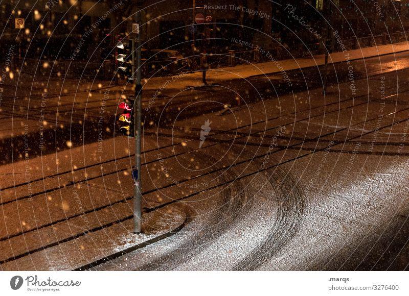 winter night Winter Snow Snowfall Transport Traffic infrastructure Street Traffic light Skid marks Dark Moody Loneliness Lanes & trails Colour photo