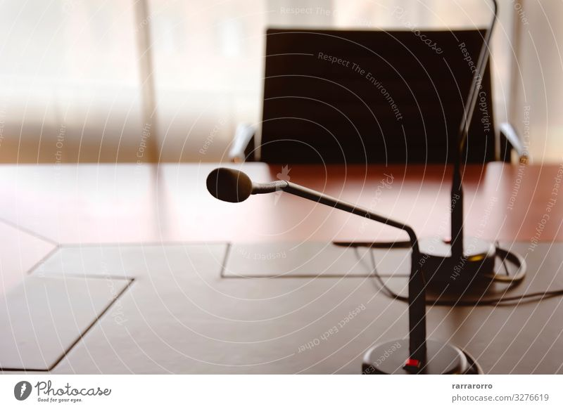microphone on a wooden table Chair Table Club Disco Audience Adult Education Office Business Meeting To talk Media Places Wood Communicate Planning Date board