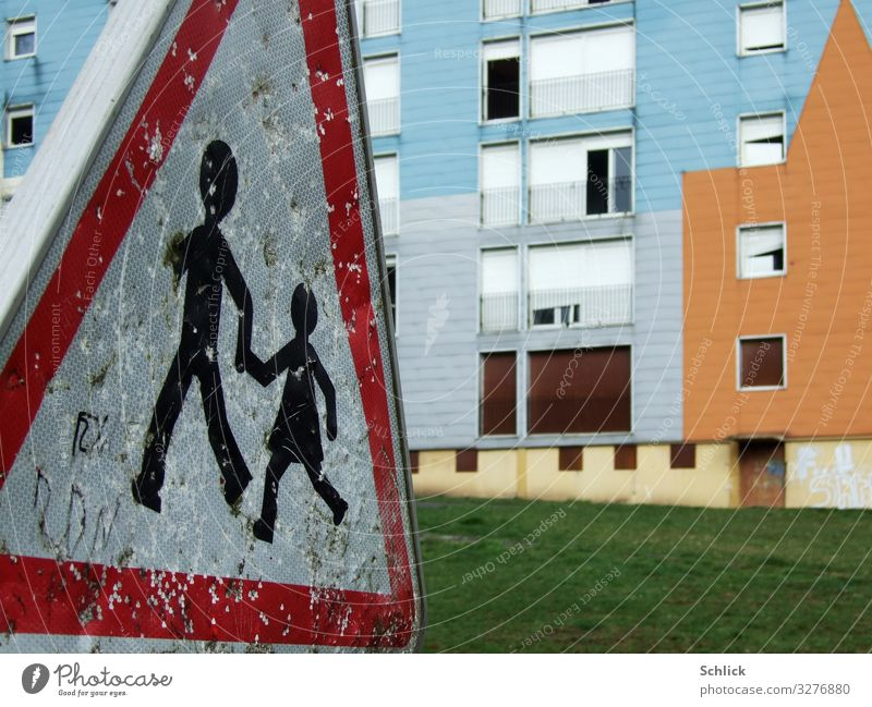 """Children in danger House (Residential Structure) Ruin Facade Road sign Metal Sign children Blue Brown Green Red White Poverty Threat Infancy Decline """"Children,"""""""