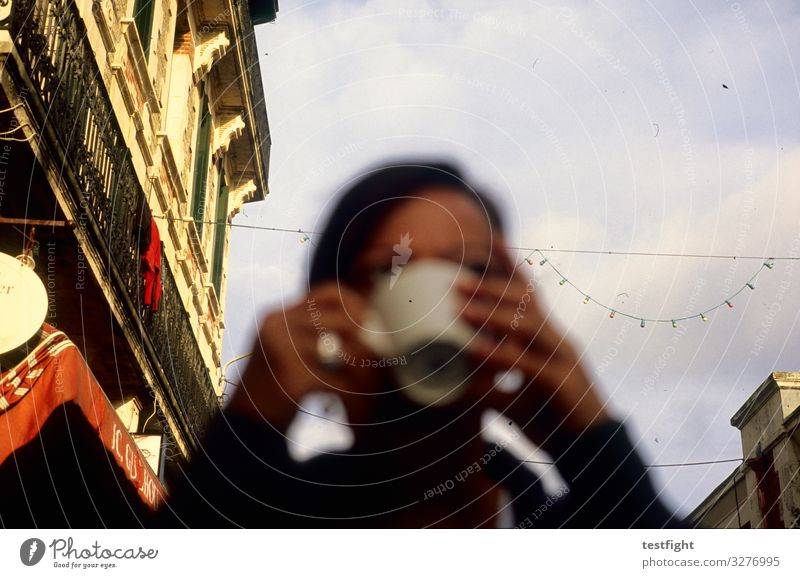 have coffee Drinking Coffee Feminine Woman Adults Face 1 Human being Town Old town House (Residential Structure) Facade Sit To enjoy Colour photo Exterior shot