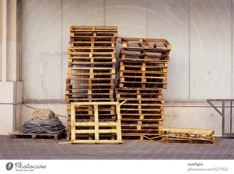 Pallet stacks Palett pile Warehouse Architecture Transport Industry logistics Logistics Storage Industrial Photography Building Factory Industrial plant Trade