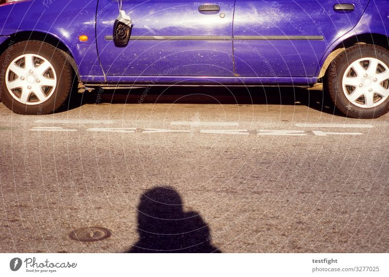 blue car 1 Human being Transport Street Vehicle Car Old Dirty Broken Shadow Wheel Wheel rim Rear view mirror Colour photo Exterior shot Copy Space middle Light