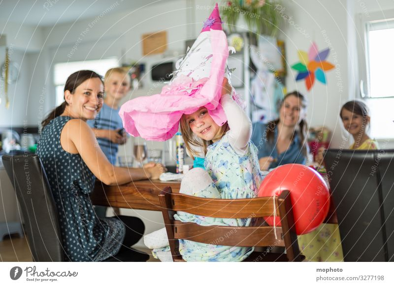 Girl with a school bag on her head, school enrolment party First day at school celebration girl School Schoolchild Parents First class first school day Family