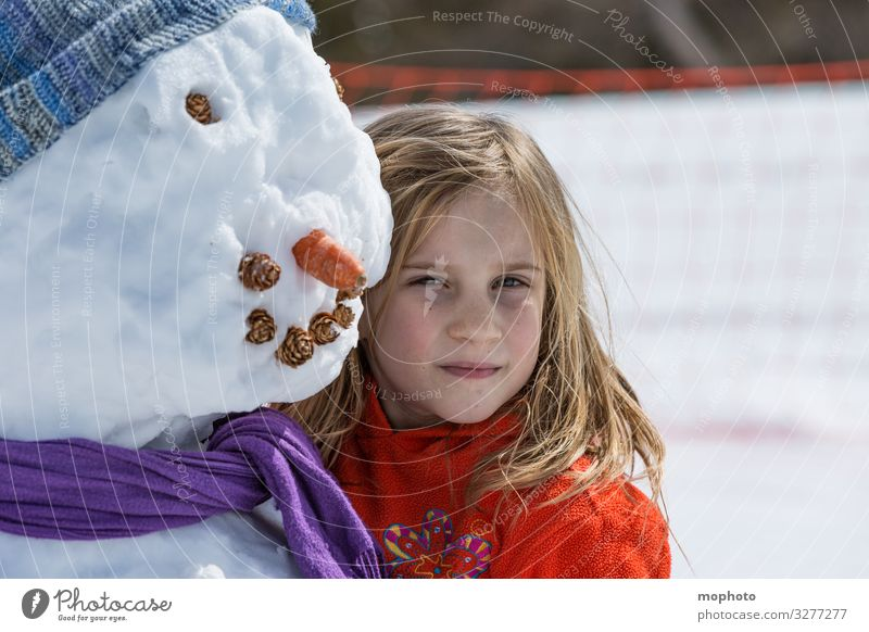 Girl with snowman girl Eyes Trip holidays Joy cheerful Happiness Face luck fortunate jeizinen chill carrot Child Head Laughter Leukerbad smile Mouth peel Snow