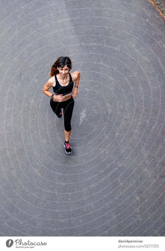 Aerial view of female runner Leisure and hobbies Sports Success Human being Woman Adults Nature Street Lanes & trails Aircraft Sneakers Fitness Smiling Thin