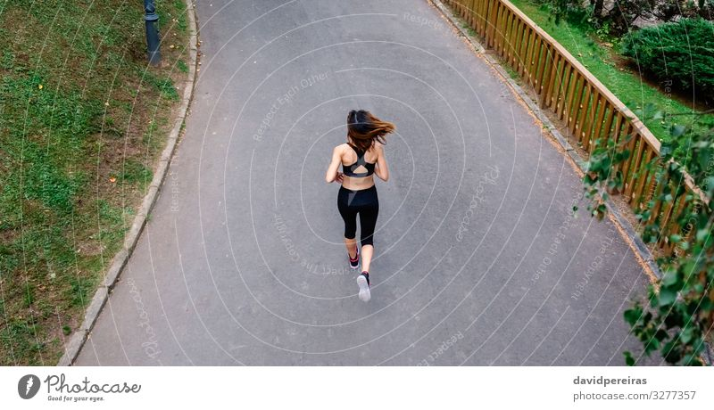 Aerial view of female runner Leisure and hobbies Sports Human being Woman Adults Nature Plant Grass Street Lanes & trails Sneakers Fitness Thin Endurance Effort
