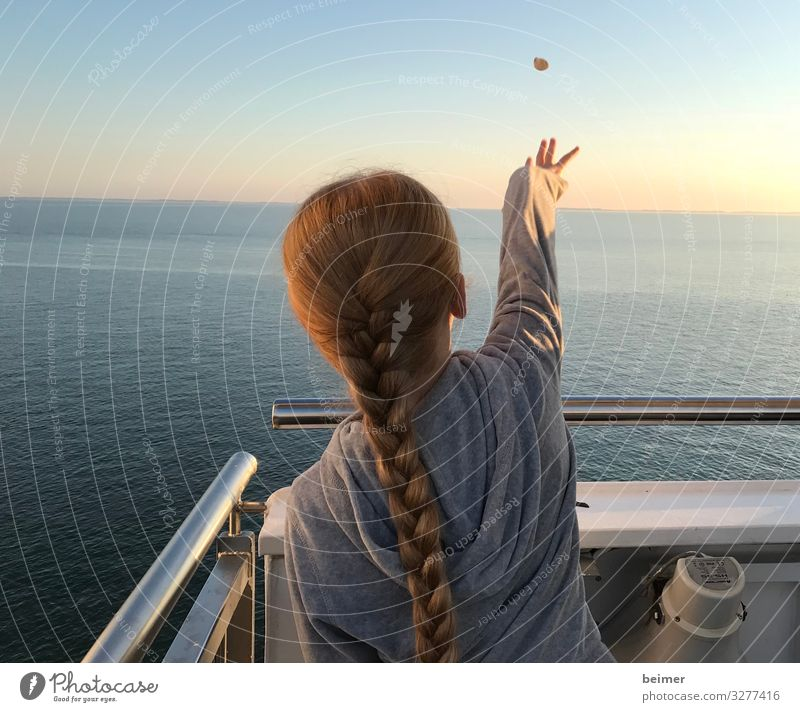 Make a wish. Far-off places Girl Hair and hairstyles Back 1 Human being 8 - 13 years Child Infancy Water Cloudless sky Horizon Sunrise Sunset Summer Ocean