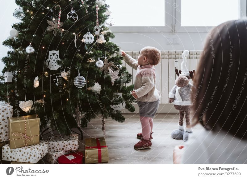 happy mother and baby girl decorating the Christmas tree Mother motherhood Happy Cute Baby Girl one year Christmas & Advent Tree Joy Family & Relations Love