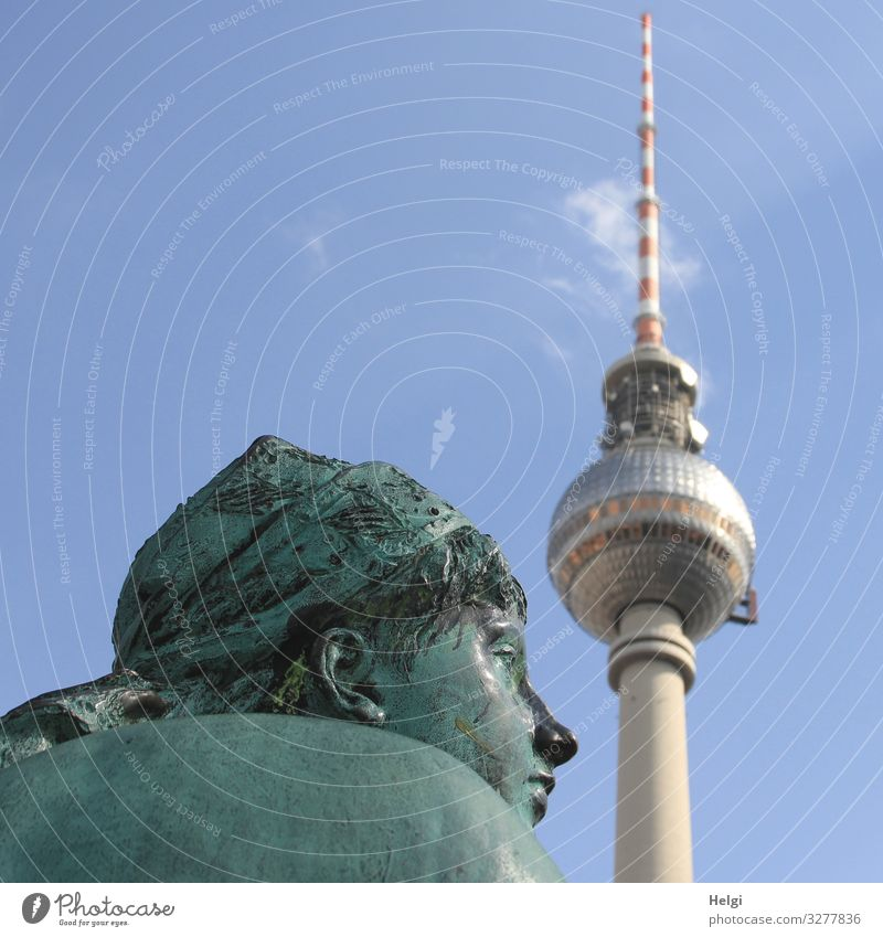Bronze figure of the Neptune Fountain next to the Berlin TV Tower Tourism Art Work of art Sculpture Architecture Sky Clouds Neptune Well Tourist Attraction