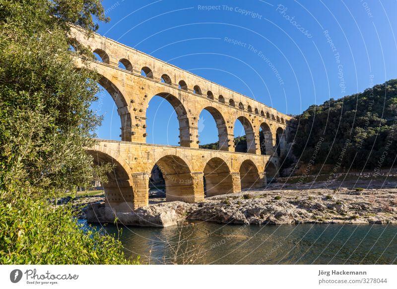 Pont du Gard is an old Roman aqueduct near Nimes Sky Old Summer Landscape Architecture Stone Earth Europe Culture Bridge Historic River France Monument
