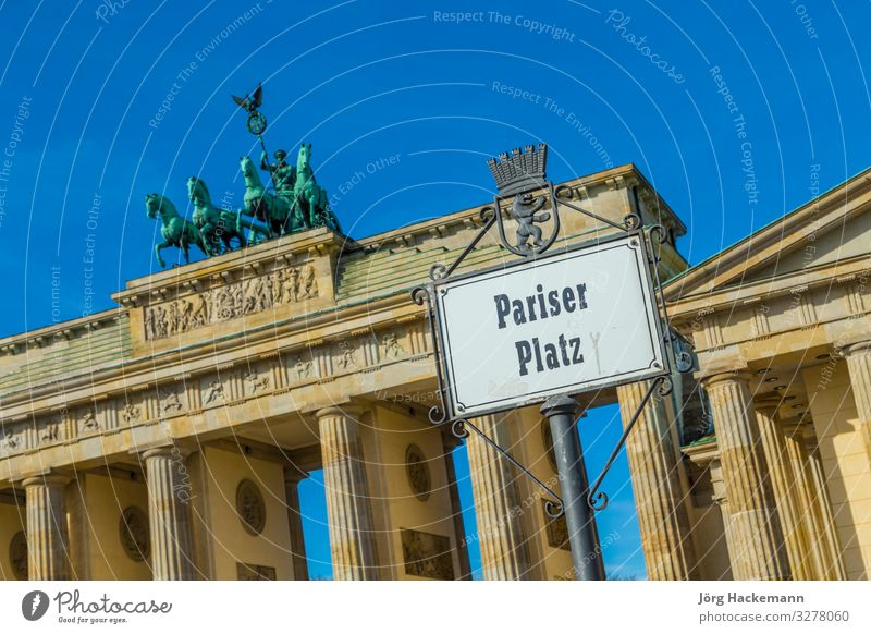 street sign Parisien Place at the Brandenburg gate Vacation & Travel Places Historic Tall Berlin Gate Goal architecture blue building capital City Europe German