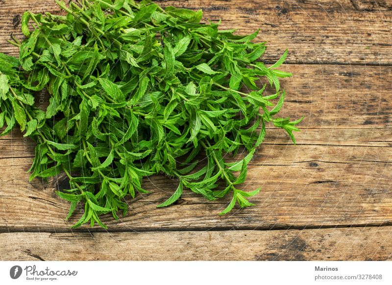 spearmint on a wooden table Herbs and spices Vegetarian diet Diet Nature Plant Leaf Fresh Natural Green White Mint background food healthy Organic Ingredients