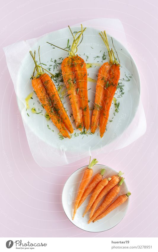 Delicious roasted carrots from above Vegetable Herbs and spices Lunch Dinner Vegetarian diet Diet Healthy Eating Fresh Natural Above Orange Pink Carrot