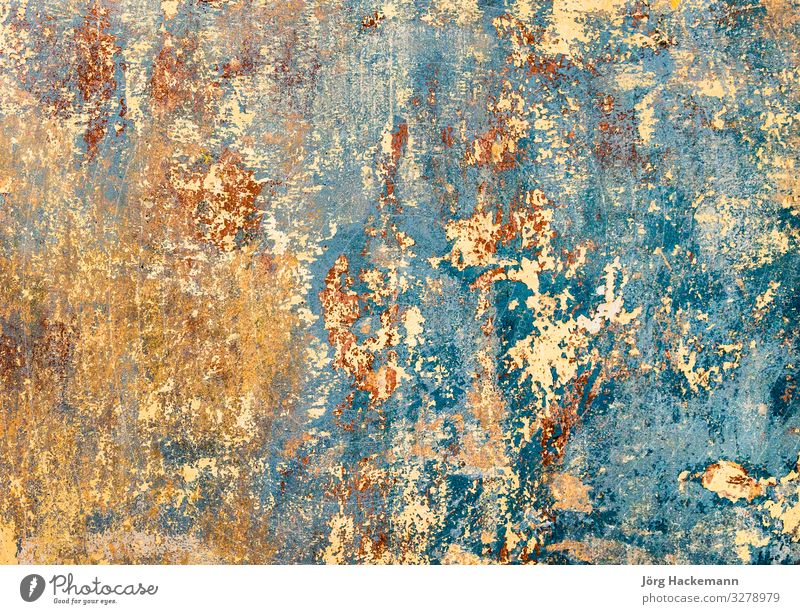 old grunge wall of an old house with remainings of color Wallpaper Stone Old Dirty Retro Strong Antique background brick Cement chipped Rough Crack & Rip & Tear