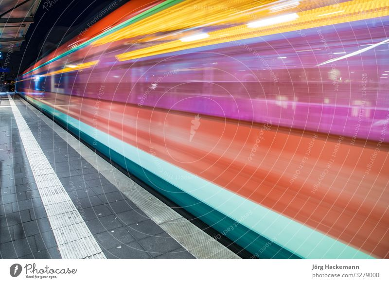 train with speed in train station Transport Railroad Commuter trains Underground Speed Station Germany Symbols and metaphors Blur Colour photo Motion blur