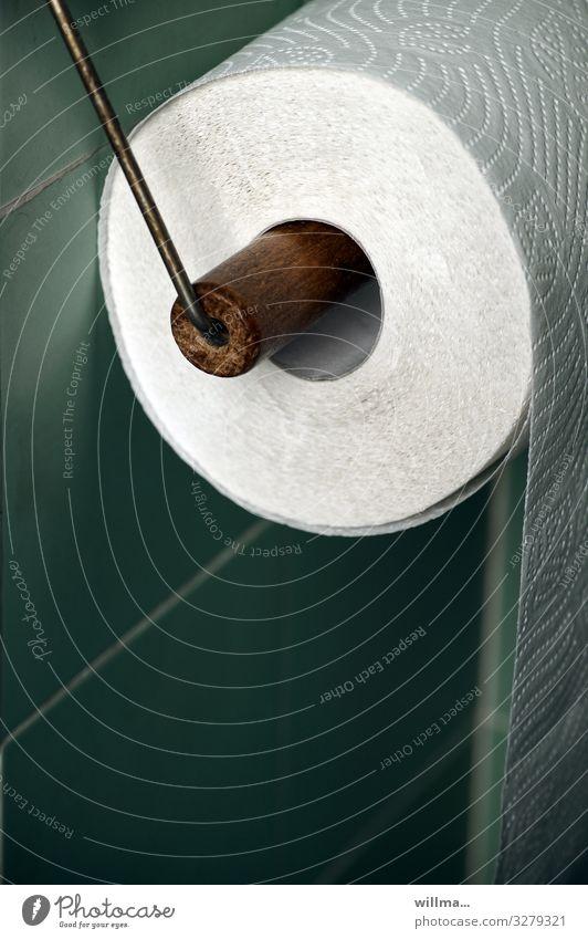 a roll of toilet paper Toilet paper Toilet paper holder bathroom tiles Tile Body care tools Turquoise Nostalgia Arrangement Perforation Detail