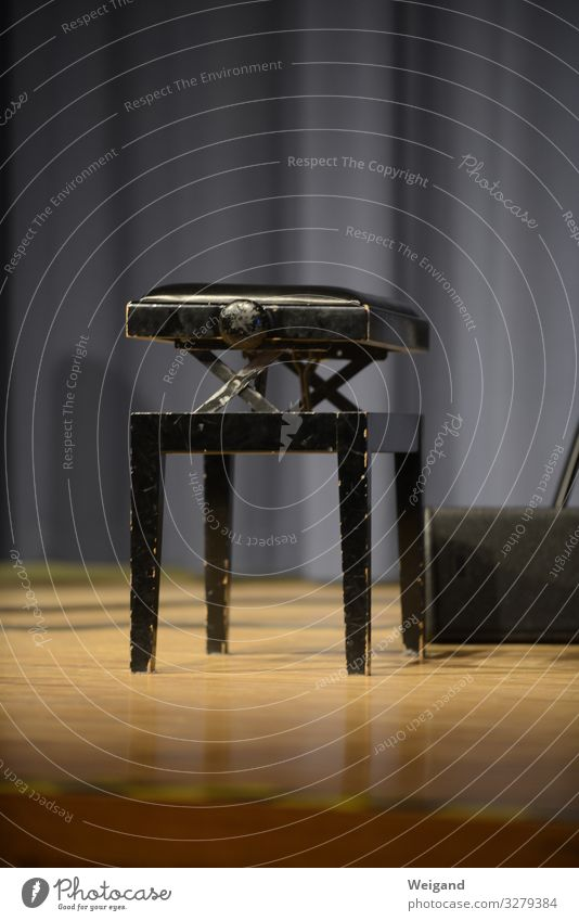 stool Event Music Curiosity Serene Concert Stage Piano Stool Airplane takeoff Empty Interior shot Copy Space top Copy Space bottom Shallow depth of field