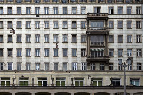 Facade in the Karl-Marx-Allee, Berlin stalinallee Downtown Berlin Town Capital city Deserted High-rise Architecture Wall (barrier) Wall (building) Window Oriel
