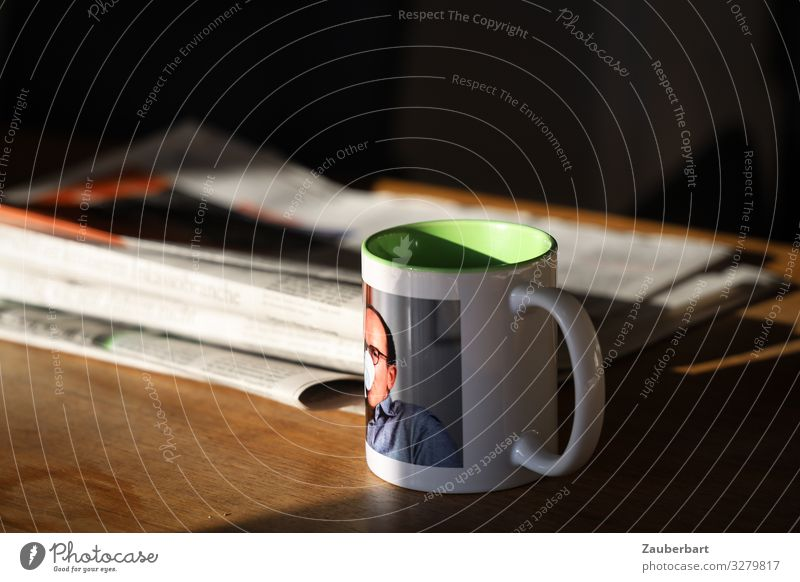Selfie-cup Drinking Hot drink Coffee Cup Mug Living or residing Table Man Adults 1 Human being 45 - 60 years Newspaper Magazine Reading Warmth Serene Interest