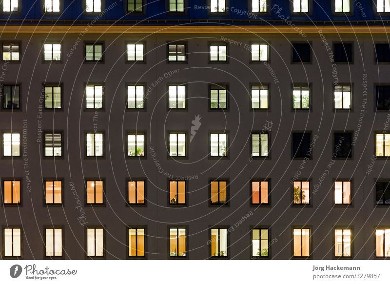 illuminated windows in a facade of a government building Harmonious Work and employment Office Building Architecture Facade Esthetic Moody Trade Safety light