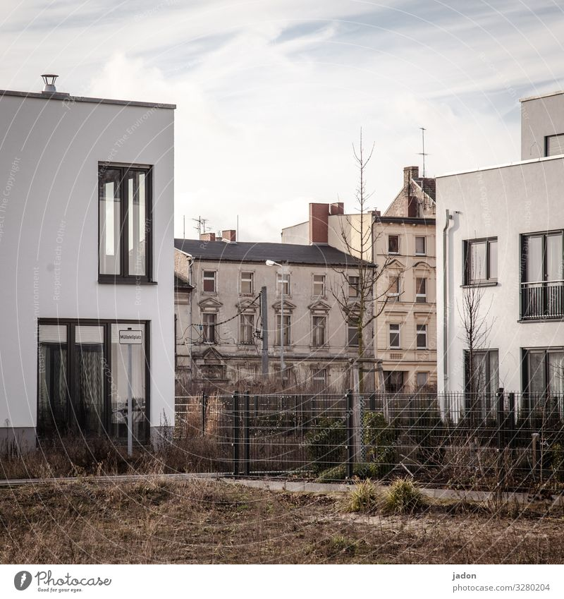 dualism. Nature Beautiful weather Grass Town House (Residential Structure) Detached house Building Architecture Wall (barrier) Wall (building) Facade Garden