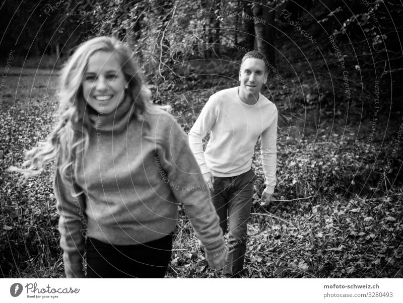 couple woman man in the forest autumn black and white Masculine Feminine Woman Adults Man Couple 2 Human being 30 - 45 years Autumn Forest Pants Sweater