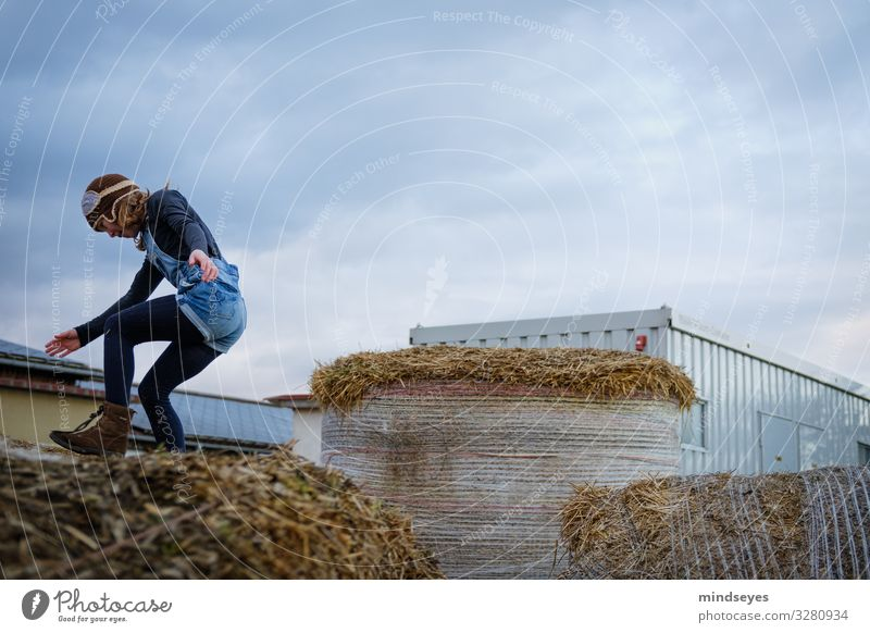 The Landing Joy Leisure and hobbies Playing Farm Child Girl 1 Human being 3 - 8 years Infancy Clouds Straw Bale of straw Cap Flying Jump Happiness Healthy Happy