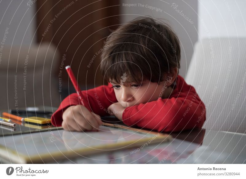 Homeworker Table Living room Child School Boy (child) Infancy Book Sit Cute Caucasian concentrating domestic life education kid Lean 1 Person real people