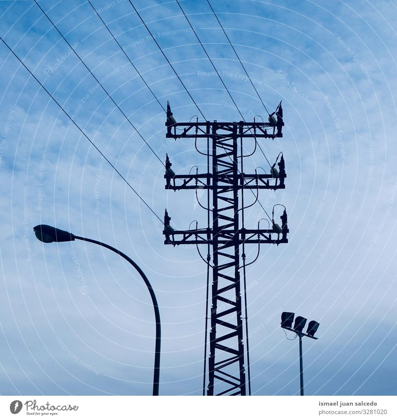electricity tower and street lamp electric tower energy communication antenna cable minimal power voltage technology industry industrial line high voltage