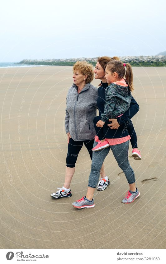 Three generations female looking at sea Lifestyle Joy Happy Beautiful Beach Ocean Child Human being Woman Adults Mother Grandmother Family & Relations