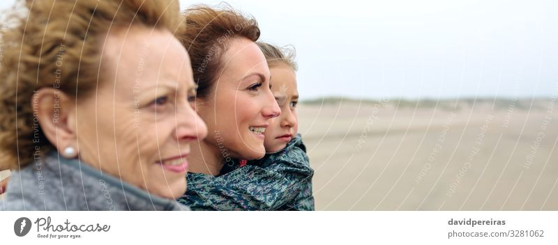 Three generations female looking at sea on the beach Lifestyle Joy Beautiful Beach Ocean Child Internet Human being Woman Adults Mother Grandmother